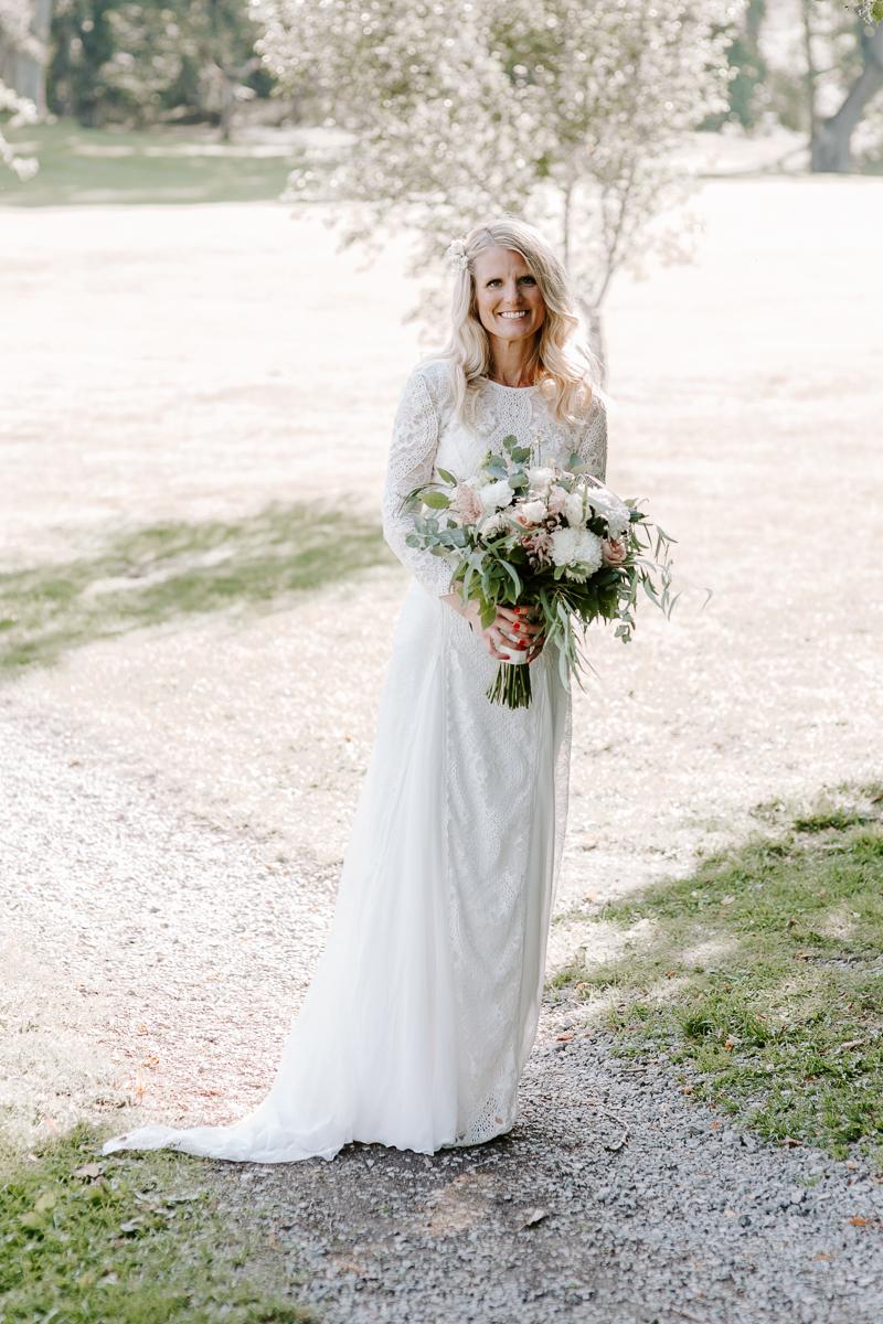 Bride wearing a Grace Loves Lace 2019 wedding dress