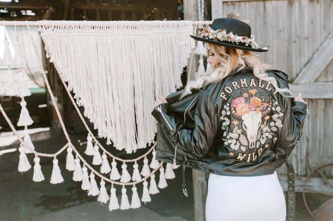 Bohemian bride wearing a handmade leather jacket