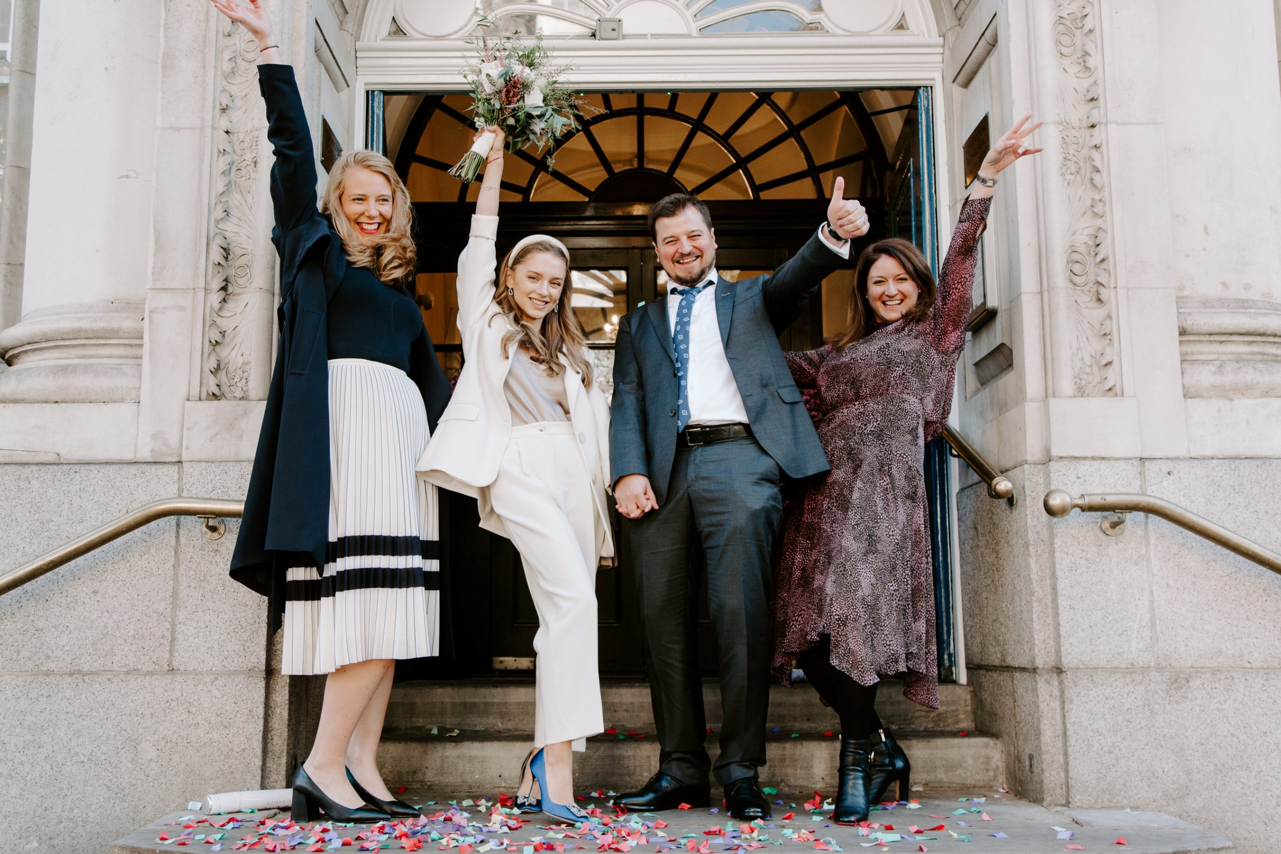 Wedding party on steps of Chelsea Town Hall