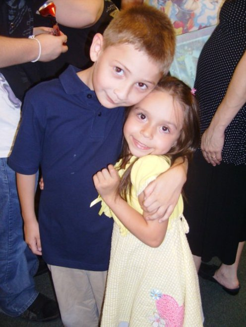 Me and my uncle Sebastian at our Pre-K Graduation.