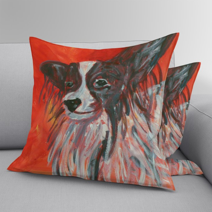 Red dog cushion with Papillon dog design on both sides