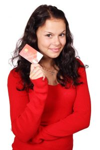 girl holding credit card