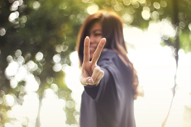peace sign girl