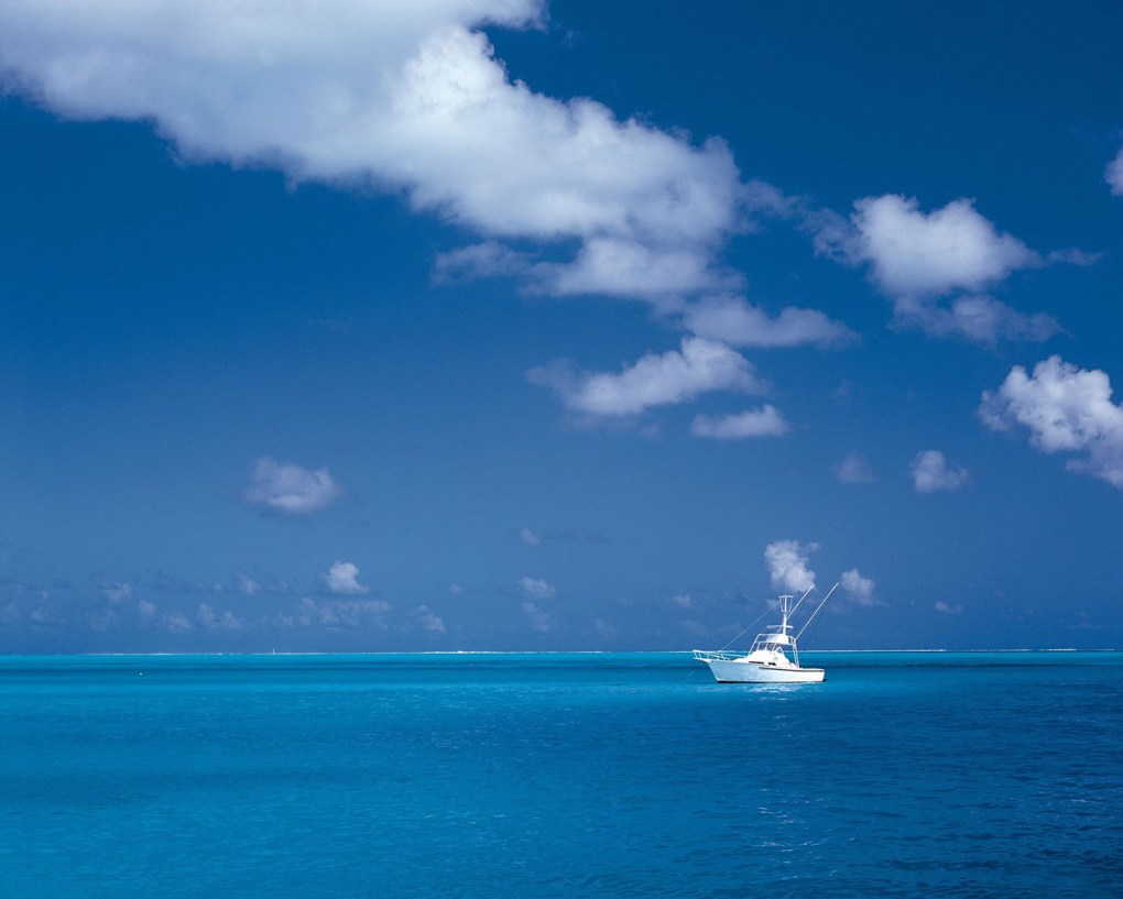 White Boat On Teal Blue Water Caribbean