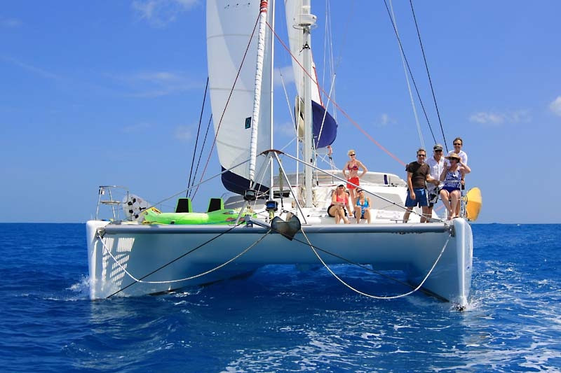 Passengers on the deck of the 58ft sailing yacht catamaran YES DEAR