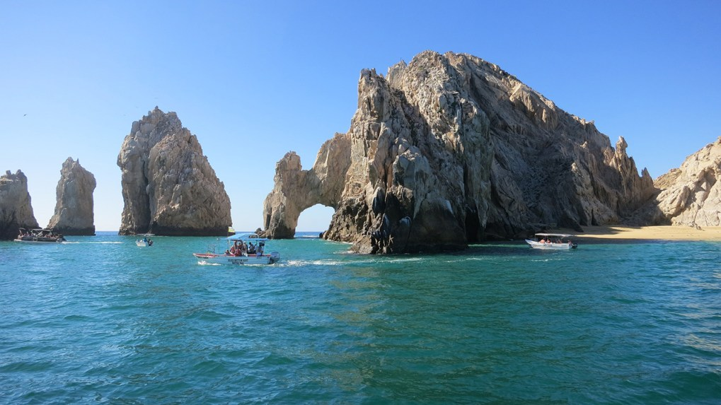 Stone arch in Cabo, Mexico with shuttle boat