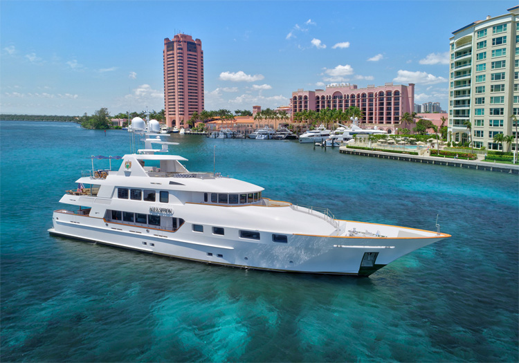 Main shot of 142ft motor yacht AQUASITION cruising Operating in the Bahamas and the North America
