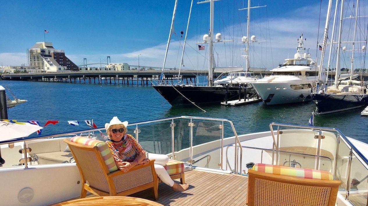 Carol Kent in a comfy chair on board a yacht deck in Newport, Rhode Island