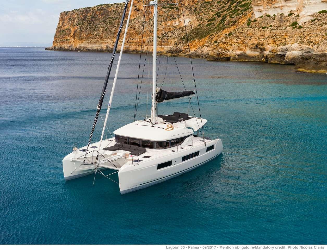 Karma 50ft Lagoon S-Y catamaran at anchor