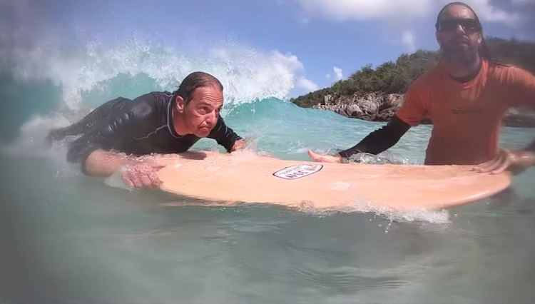 LOLALITA guest on surfboard with surfing instructor in British Virgin Islands