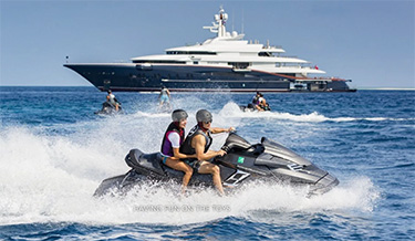 Couples on jet skis playing off 290ft Oceanco superyacht NIRVANA