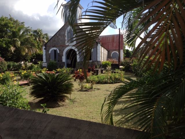 Church with lush tropical garden on St. Barths in the Caribbean