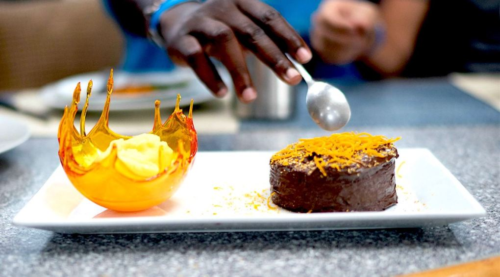 Orange sugar glass ice cream bowl and chocolate cake with orange peel at the US Virgin Islands Charter Yacht Show 2020