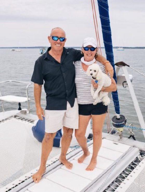 Capt. Steven & Capt. Bonnie Carroll w dog Sailor aboard 50ft sailing catamaran PARADIGM SHIFT