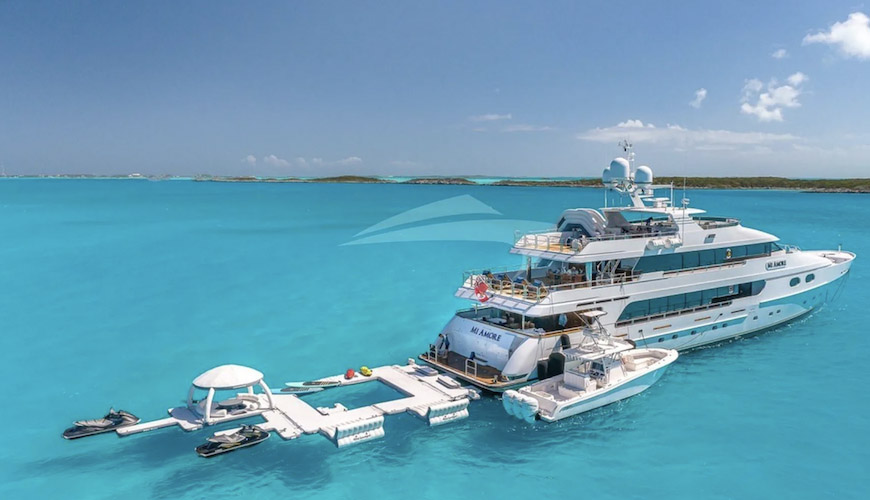 157ft Christensen motor yacht MI AMORE with its many toys and tenders on the water