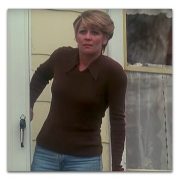 *Woman in brown sweater