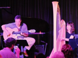 photo of Larry Koonse playing guitar on stage with Carol Robbins playing harp Upstairs at Vitello's in 012