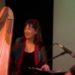 Photo of Carol Robbins with her harp beside saxophonist Bob Sheppard