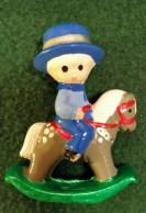 Wee Ones boy on rocking horseorn