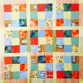Carols Quilts scrap squares quilt with logo
