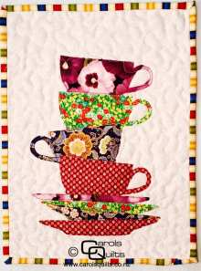 Small teacups stacked with copyright Carols Quilts