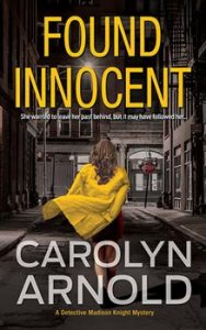 Found Innocent by Carolyn Arnold, a woman in a yellow overcoat running down an alley at night