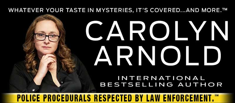 Author Carolyn Arnold holding a Stiles Police Detective badge International Best Selling Author