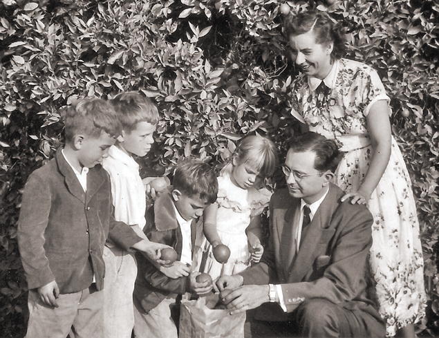 Baldwin family photo 1952, picking oranges in California