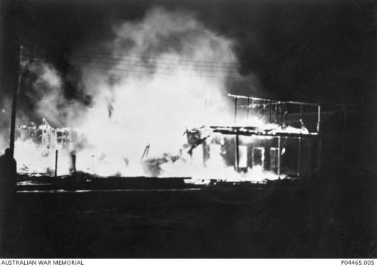 Nighttime: Blazing buildings after the bombing. Source: Australian War Memorial