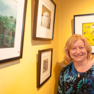 Image of artist Carolyn Murphy at one of her exhibitions 'Spectrum' in Didsbury 2015