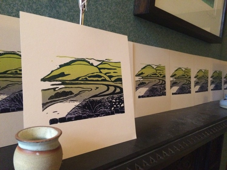Image of Carolyn Murphy's 20:20 print exchange linocut edition 'Meandering' drying on the mantelpiece