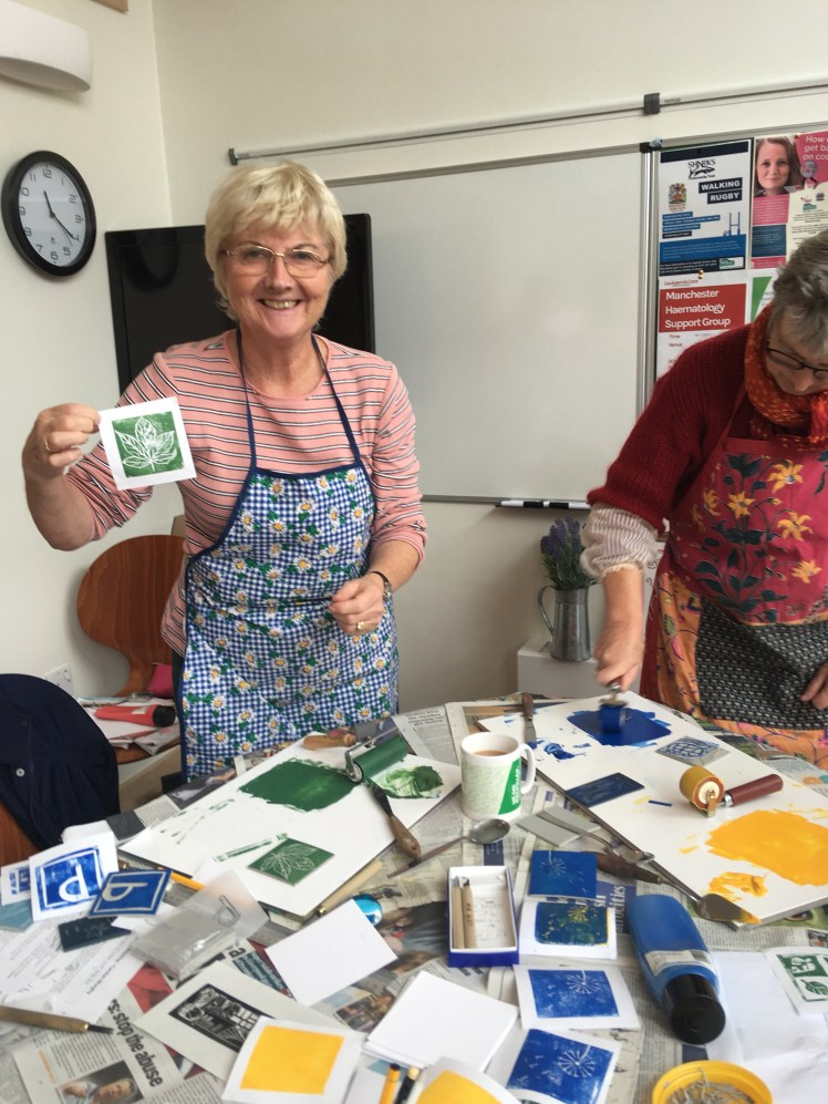Image of Macmillan Craft & Chat group with their linocut work