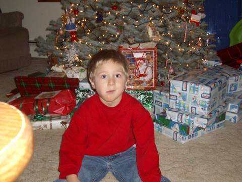 Josiah in front of the tree