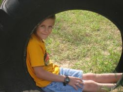 Zachary in the tire at the park in Harrisville