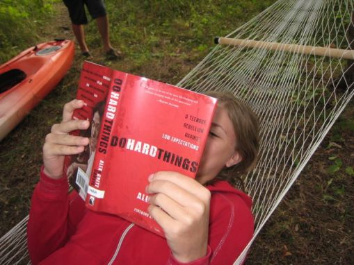 "Kristi reading ""Do Hard Things"" while relaxing in the hammock"