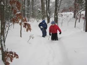 Josiah and Zachary walking on the snowy trail