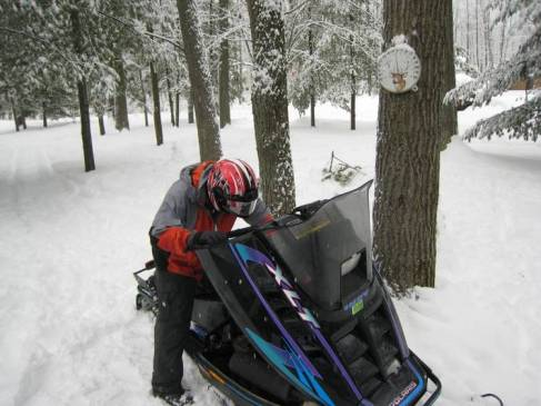 Taylor getting the snowmobile ready