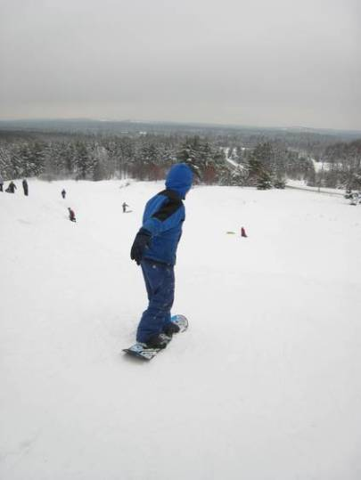 Zack on his snowboard