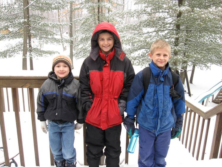 Josiah, Jacob and Zachary on the snow covered deck