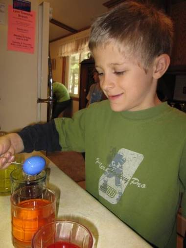 Zachary decorating eggs