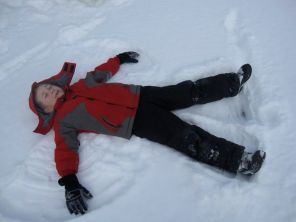 making a snow angel on the lake