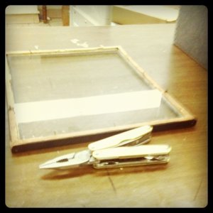 Photograph of a multitool and a broken photo frame