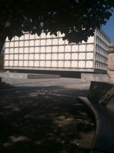 View of the Beinecke Library from a shady tree