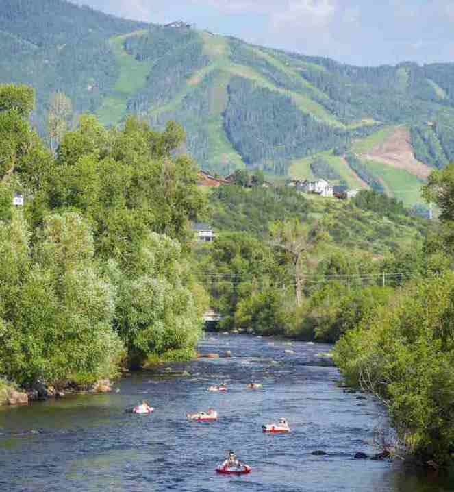 Things to do in Steamboat Springs with Kids - tubing down the Yampa River. Click through for more summer and winter activities in Steamboat Springs.
