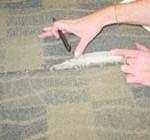 Delamination of a carpets back at a seam