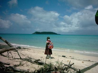 Paradise beach, schoolgirl walking home.