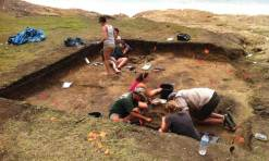 Archeologists uncovering part of the site.