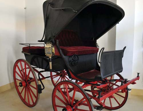 one of the family's carriages in the second storage area