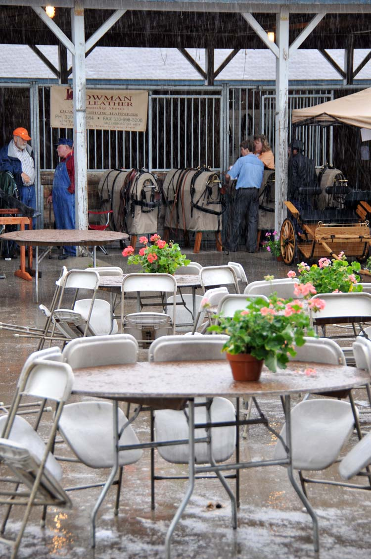 ... and then, sadly, this was the scene in the vendor area about ten minutes later (fortunately, everyone seems to have brought their wet-weather gear, even if they don't have it with them at all times)