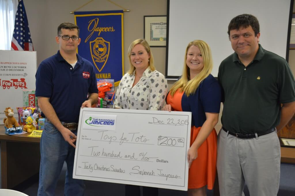 (LEFT to RIGHT) SSt. Riddle, Marine Toys for Tots; Lauren Matthews, Cheryl Lawrence and Will Gruver, with the Savannah Jaycees